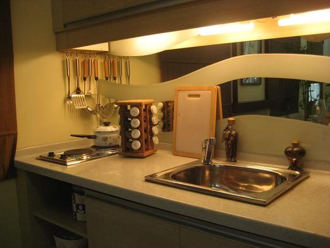 Zen interior design 30 sqm condo condominium interior for Kitchen design 7 x 9