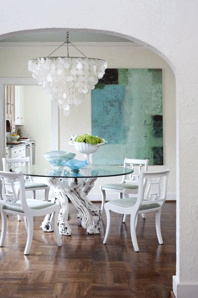 Beachy dining room. Love that fabulous capiz shell chandelier and how the table base looks like driftwood.