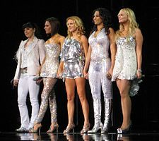 """Spice Girls- were an English pop girl group formed in 1994. The group consists of Melanie Brown (""""Scary Spice""""), Melanie Chisholm (""""Sporty Spice""""), Emma Bunton (""""Baby Spice""""), Geri Halliwell (""""Ginger Spice""""), and Victoria Beckham, née Adams (""""Posh Spice""""). They were signed to Virgin Records and released their debut single """"Wannabe"""" in 1996, which hit number one in 37 countries and established them as a global phenomenon. Their debut album Spice sold more than 31 million copies worldwide,"""