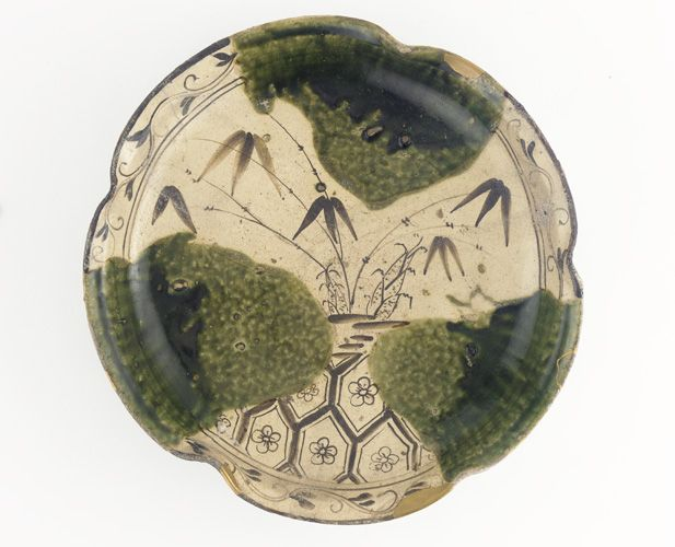 Mino Ware, Oribe Style Bamboo Shoots Dish. Stoneware with Oribe Glaze and Iron Decoration under Clear Glaze. Momoyama to Edo Periods, Circa 17th Century. 8.3cm x  37.0cm.