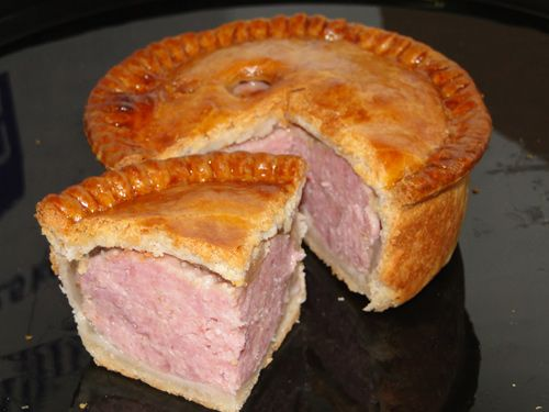 'Pork Pie'. Pork & pork jelly set in a simple hot water crust.Served cold as either a snack or as part of a meal.Two well-known versions: the first being the classic which uses minced & cured pork,which retains its lovely pink color when cooked.It's also cooked in a mold or pork pie dish so that the straight-sided silhouette can be achieved.The Melton Mowbray pork pie,uses uncured pork as well as a hand-formed crust. Alongside your pie would be a bottle of HP sauce, mustards, pickles…