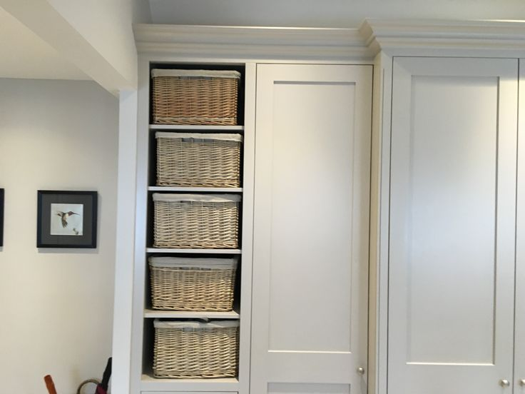 Why not integrate baskets into your cupboard design? Bespoke furniture at affordable prices. www.cobwebsfurniture.co.uk