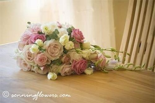 Pink and cream roses teardrop bouquet