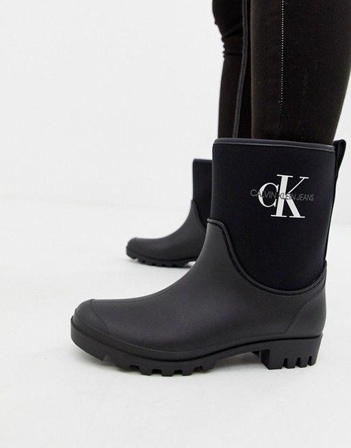 Calvin Klein Jeans Philippa black ankle wellington boots  de6f9704a9