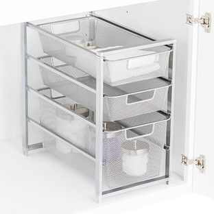 Our 2-Drawer Mesh Organizer is perfect for keeping cleaning supplies tidy, food packet and boxes organized, or cosmetics and toiletries in order.  Each basket slides out completely so you can take it where you need it.    The tight-weave white mesh keeps smaller item from falling through.