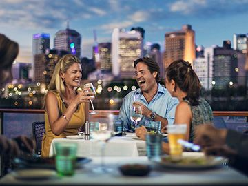 people enjoy dinner at Stokehouse Q in South Bank