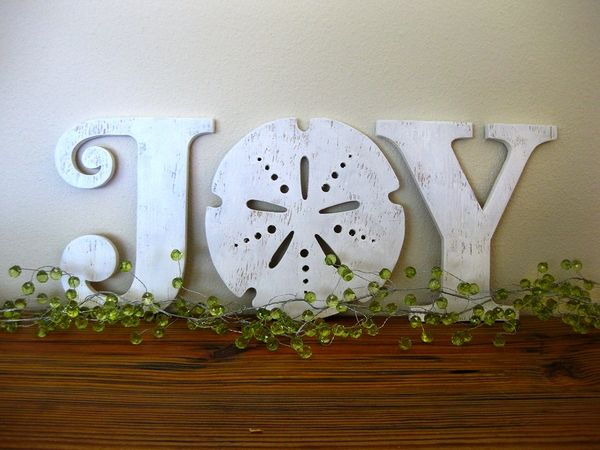 Adorable sand dollar beach Christmas sign perfect for the mantle of a beach house