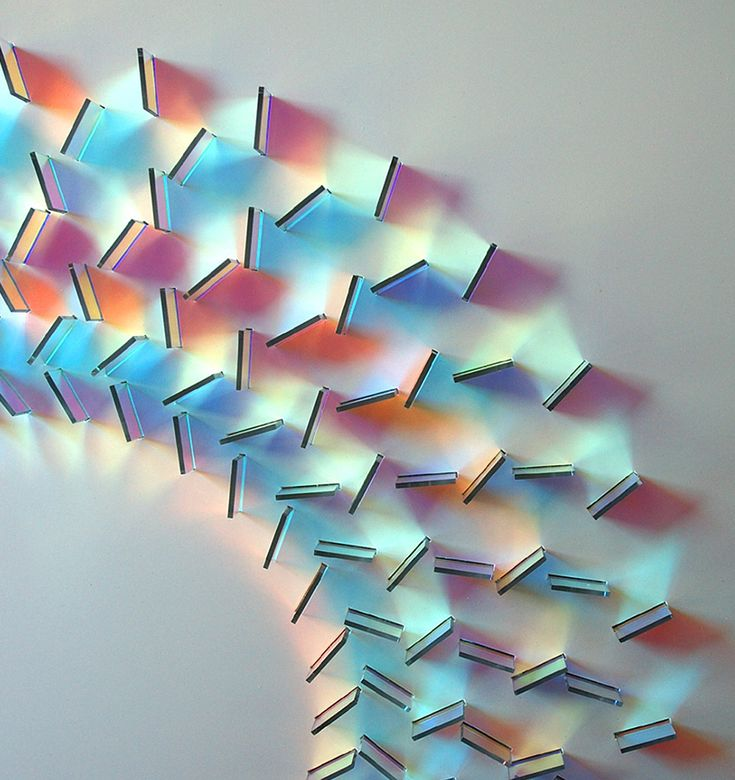 Iridescent pieces of glass create geometric patterns with light