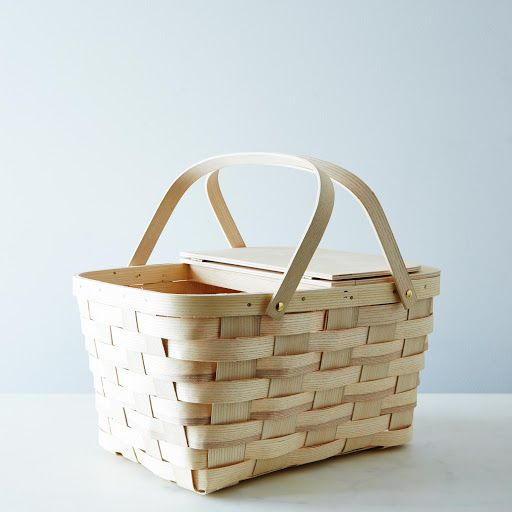 Brad and I are thinking to start buying any cheap picnic baskets that we can find that are the wood/wicker look. Then we can have a basket for each table (30 ish?) and have sort of an eclectic array of baskets that are all very similar.