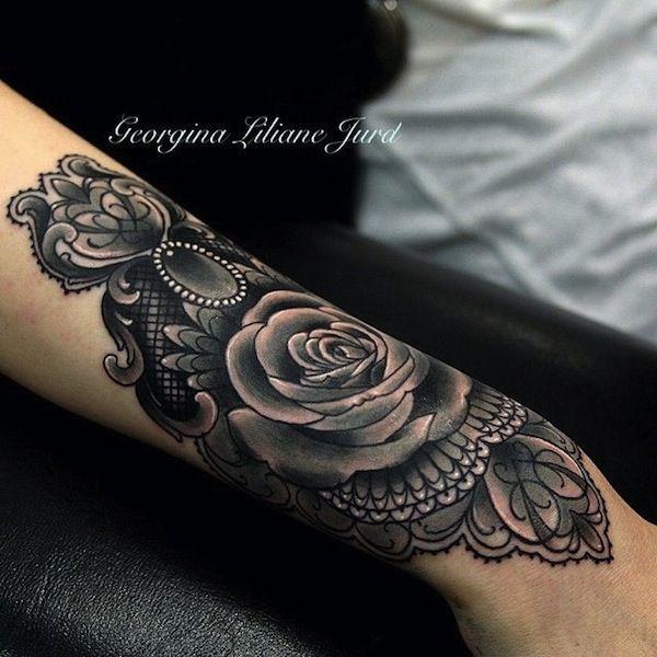 Black and grey flower tattoo on woman 39 s arm description for Tattoo artist job description