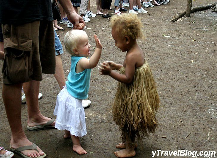 Baby Savannah meets a village girl in Vanuatu: http://www.ytravelblog.com/savannahs-first-year-of-travel/