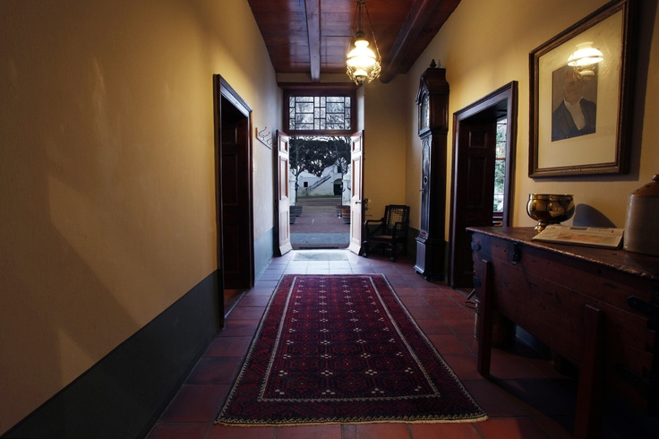 The corridor leading from the entrance into the 1773 Cape Dutch Gable,situated on Vergenoegd Wine Estate outside of Stellenbosch.