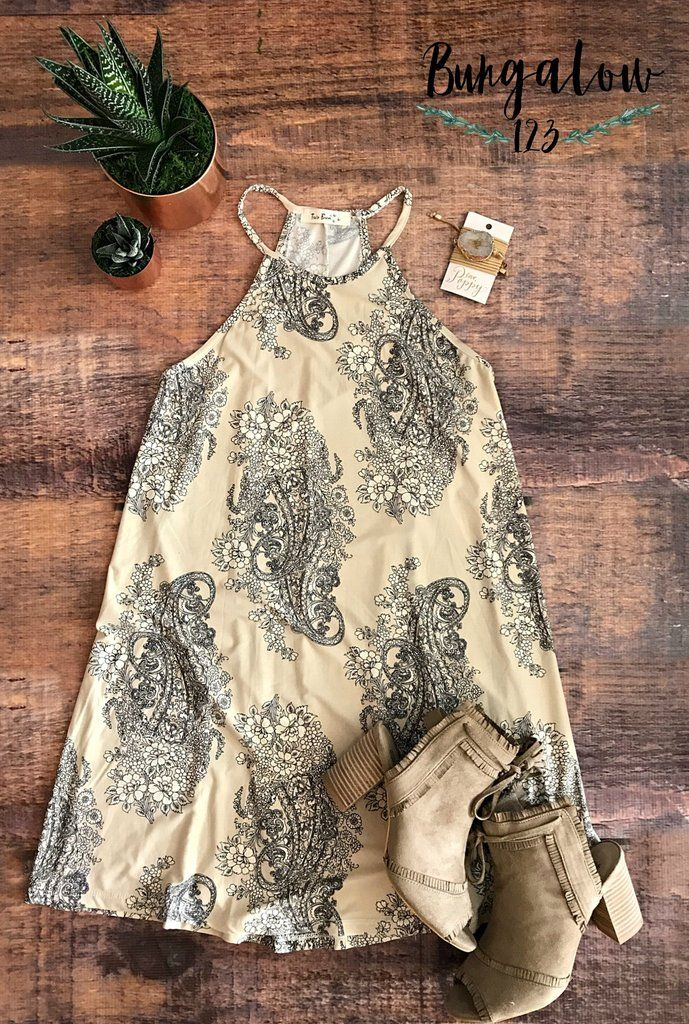 Ultra-comfortable Spring and Summer dress in Vanilla Cream featuring an allover Paisley print in black. Ultra-soft jersey material. Sleeveless with halter neckline. 90% Rayon 10% Spandex. If in-betwee