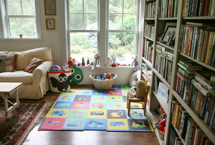 comfy mini play space and love the book shelves
