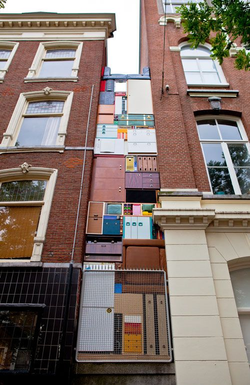 Michael Johansson|Tetris - Witte De With, 2011 Furniture, cabinets, refrigerator, electric piano, boxes, sofa, etc. Dimensions: 1,6 x 10 m. Installation view: Witte de With Straat Festival, Rotterdam (NL)