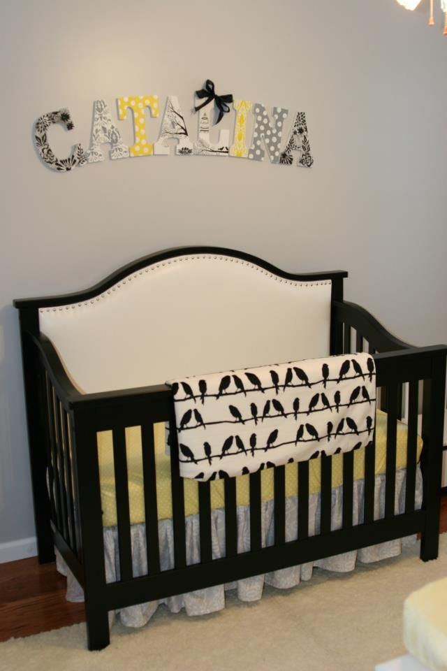 Black white yellow baby room