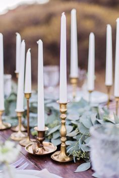 A collection of tapered candles in antique holders of different heights makes for a romantic tablescape   Marissa Kay Photography   Bridal Musings Wedding Blog