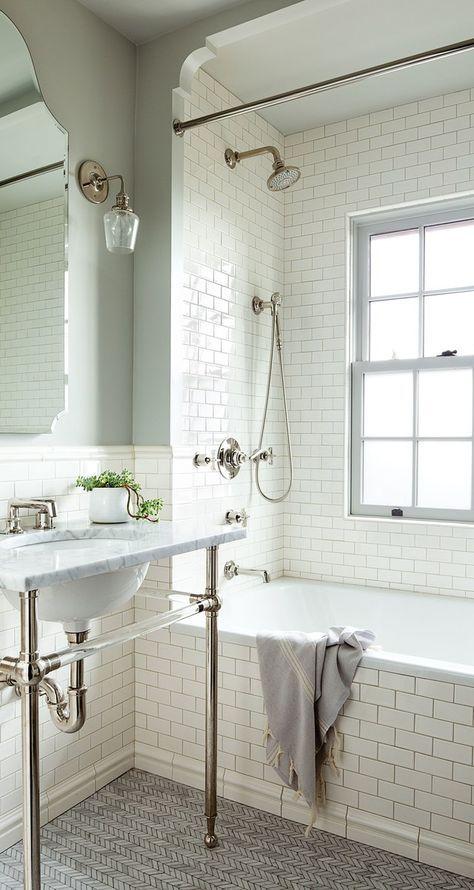Tiles by Pratt & Larson line the walls, while Ann Sacks herringbone Carrara tiles cover the floor | http://archdigest.com