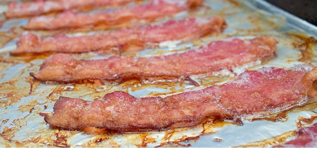 This technique provides an easy and foolproof way to make perfect bacon that is evenly crisp and flat. On top of that it requires less work and creates less mess. This bacon is baked instead of fried and once you try it this way, you will NEVER go back to frying your bacon in a pan.DirectionsLine a baking sheet with aluminum foil. Lay the slices of bacon on the lined cookie sheet. Make sure that they are NOT overlapping each other. Bake in a 400F oven for 17-22 minutes, or until desired…