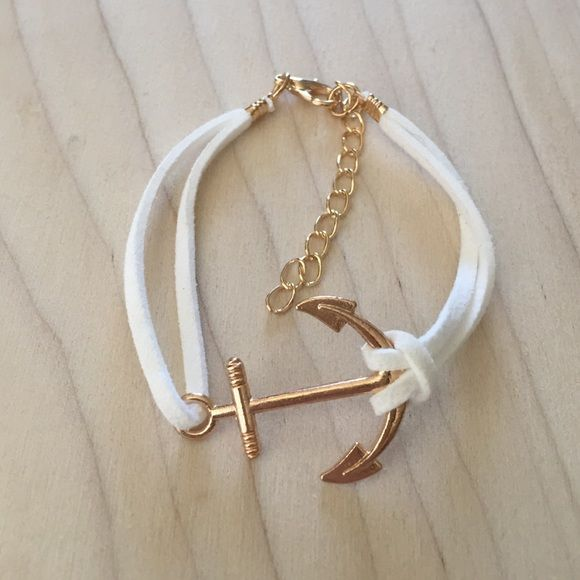 Gold and Ivory Faux Suede Anchor Bracelet Adjustable bracelet with gold anchor and white ivory wrap. Same day or next day shipping. No trades and no holds. 20% off of bundles. Jewelry Bracelets