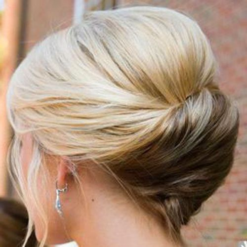 With a light bouffant and all the ends tucked inside your updo, you can create a perfect illusion of thick hair styled in the most sophisticated way. This hairdo features a twist and fabulous curvy lines for an enhanced femininity of a really statement updo.