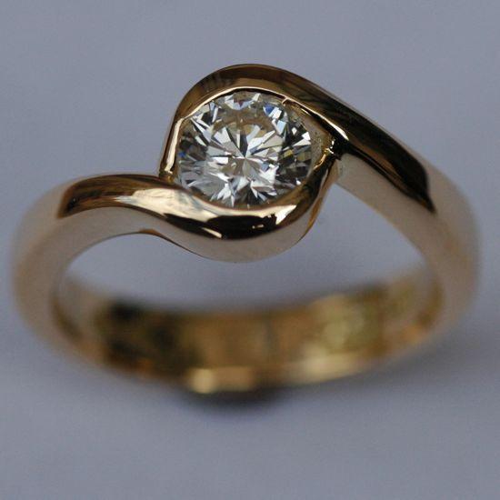 Yellow gold and 5 karat diamond engagement ring. Stunning!