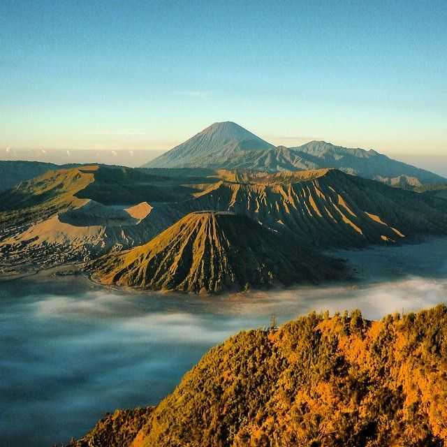 The ethereal Gunung Bromo at dawn, sitting amidst a sand-filled crater 10km wide. The magnificent Bromo Tengger Semeru National Park in Java covers 800km2 of dramatic landscapes and supernatural beauty, forming part of the infamous Ring of Fire. #volcano #indonesia #landscape