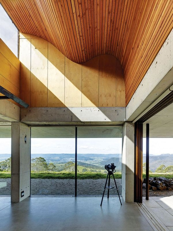 Invisible House | Peter Stutchbury Architecture; a rolling, double-height ceiling of battened timber draws light into the living area, image: Michael Nicholson
