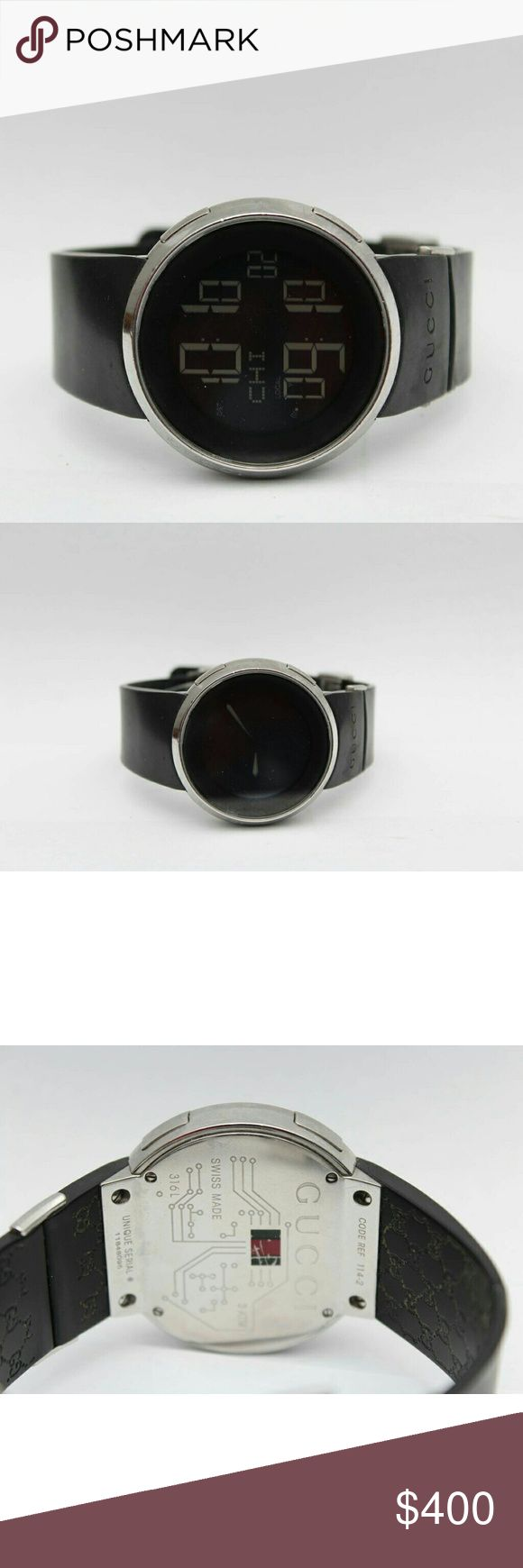 Gucci Women's Black Rubber Strap Digital Watch Case: Stainless steel  Dial: Black digital  Calender Digital dual time displays Strap: black rubber Clasp: deployment  Movement: quartz  Water resistance  Control of origin: Switzerland  Serial #: 11848095 Gucci Accessories Watches