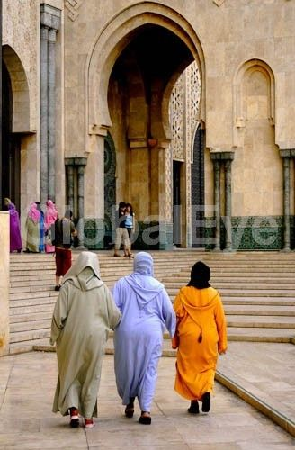 Muslim women at mosque. Three Muslim woman in traditional dress at Hassan II Mosque, Casablanca. The mosque is the 2nd largest in the world behind Mecca and the only mosque in Morocco open to non Muslims. The minaret is 210 meters tall, the world's tallest.Stock Photo By Mark   Eden