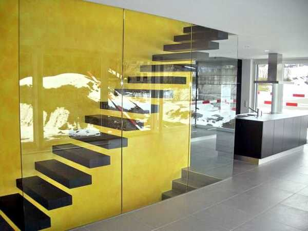 33 glass staircase design ideas bringing contemporary for Furniture for curved wall in foyer