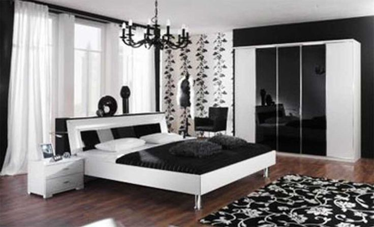 Interior Design Ideas for Bedroom with white wall color interior design and glass windows with curtains and large wardrobe beside and white wooden bed with black and white bedspreads idea