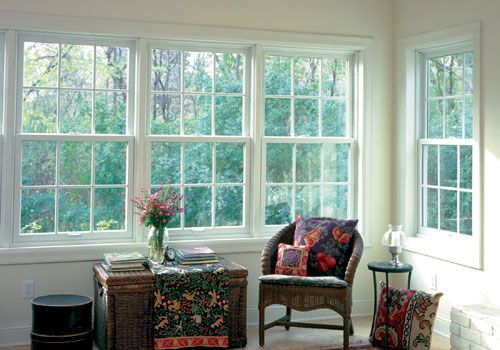 Double hung windows from Renewal by Andersen let a ton of light into this pretty room.