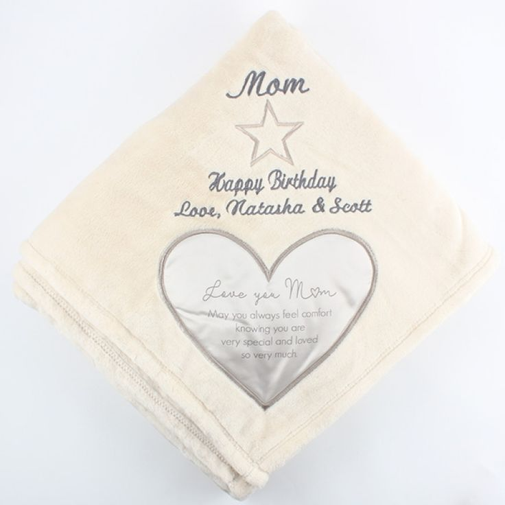 "Mom Royal Plush Blanket 50x60 - This soft, thick blanket is the perfect way to let Mom know how much she means to you. It comes with a satin heart applique in one corner that is full of comforting words. Our embroidery specialists can make this blanket even more personal by adding your own message above the satin heart. Message inside satin heart reads ""Love you Mom. May you always feel comfort knowing you are very special and loved so very much."""