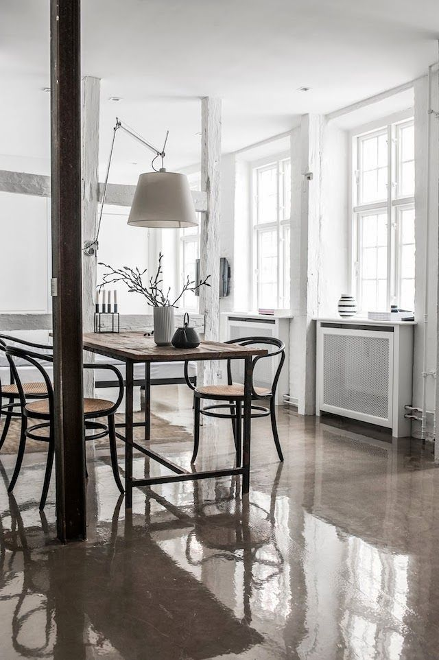 House Tour | At home with Line and Thomas Copenhagen home with a dominance of white and shiny concrete floors.