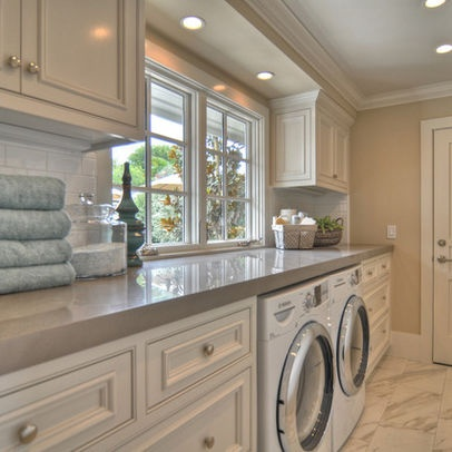 love the clean/bright colors in this laundry room.  white cabinets and light grey counter.