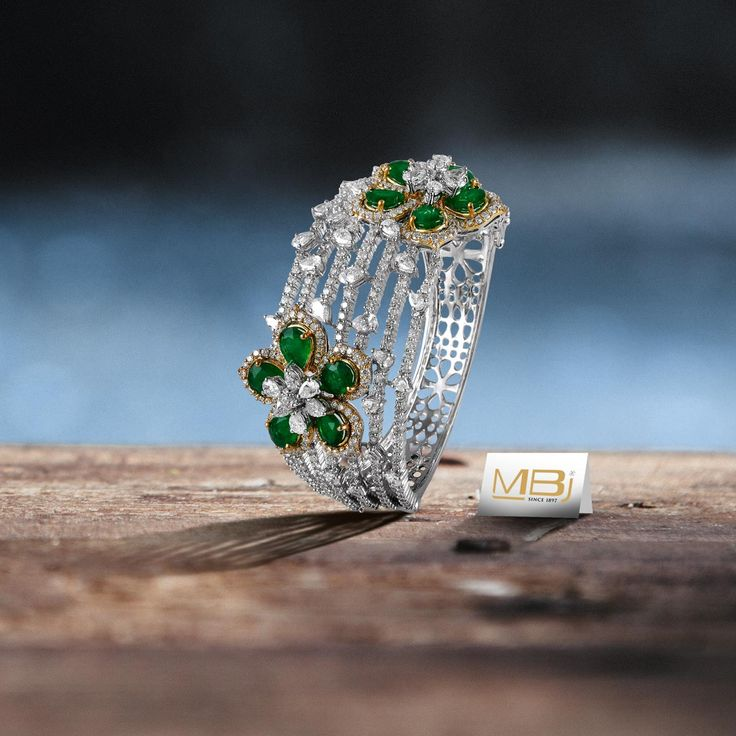 Diamond bracelet with Emeralds. #MBj #Luxury #Desirable #Modern #JewelleryLove #Bracelet