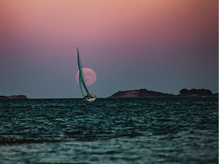 A blood moon lights a sailor's way in this National Geographic Photo of the Day.