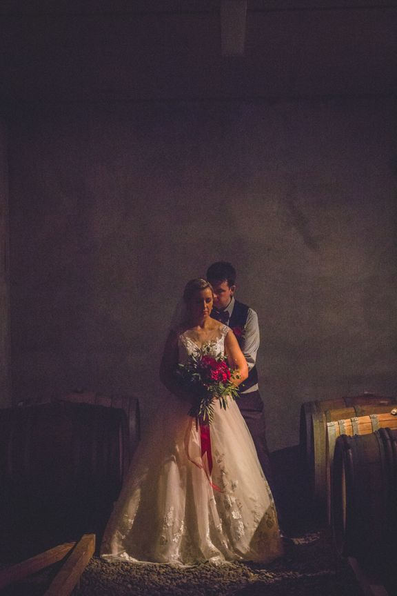 Underground barrel room - Bianca and James wedding day was a delicious tumble of rich red blooms and satin ribbon, blue gingham and bow ties, autumn colour and cute furry friends with thanks to Rei Bennett Photography.