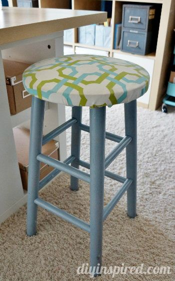 Upcycled bar stool with paint, cushion, and fabric