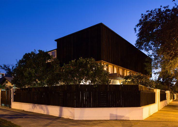 DX Arquitectos adds black wood studio to yoga teacher's house