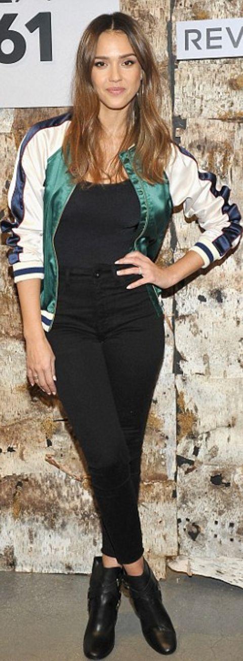 Who made Jessica Alba's green stripe bomber jacket, black top, and black skinny jeans?