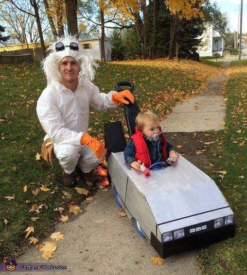 Samantha: The delorean is made out of a moving box and lots of hot glue! Doc Browns costume was order very cheap from Amazon. Wig, belt, gloves, and painter suit! Luckily...