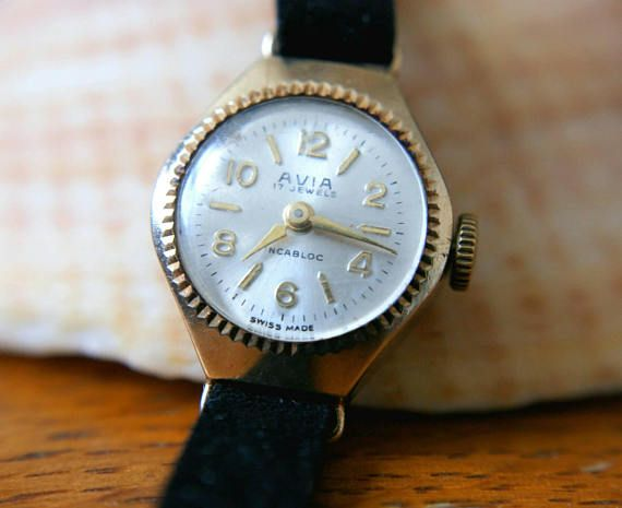 Luxurious Solid Gold watch. This Avia Swiss Watch is incased in a solid 9ct gold and we have put on a NOS Velvet watch strap.  The case bezel is beautifully cut to make it sparkle and draw attention to the beautiful dial and hands. The velvet strap adds lovely texture and interest.