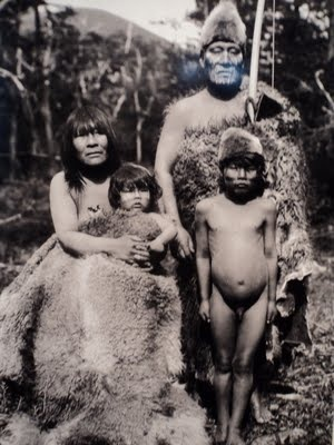 Selk'nam (Ona) family. Akukiol Halimink (famoous shaman) with his wife and children, 1919. Aboriginal village of the island Grande de Tierra del Fuego-