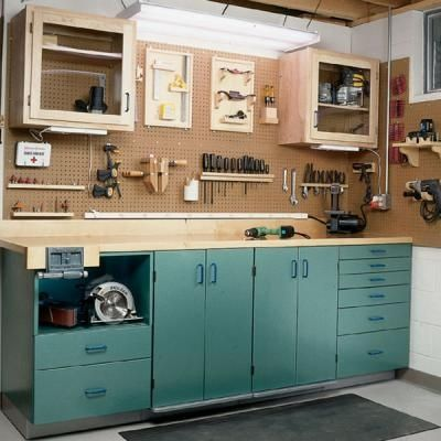 Love this workspace for the garage.. pretty, clean, great for old kitchen cabinets paint and re purpose for the garage