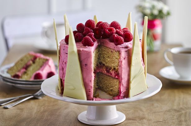 Nadiya Hussain's white chocolate crown cake really is a showstopper! This stunning cake with raspberry frosting would make a seriously impressive birthday cake