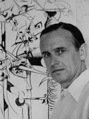 artist-graham-sutherland-standing-in-his-home-in-the-south-of-france-with-his-work-behind-him