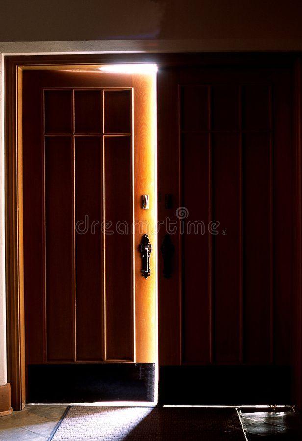 Opening Door Door Cracked Open Lets Light Into A Dark Room
