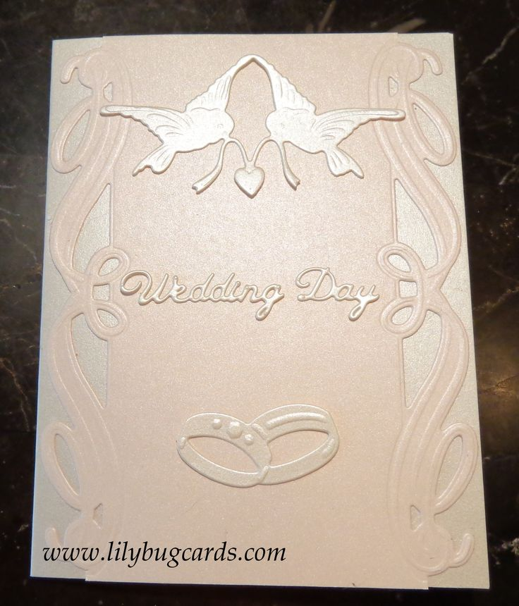 Experimenting with die cuts for the front.  card 1 of 7  nothing adhered but did finally stay with the doves and rings for base so put them on right.  :)
